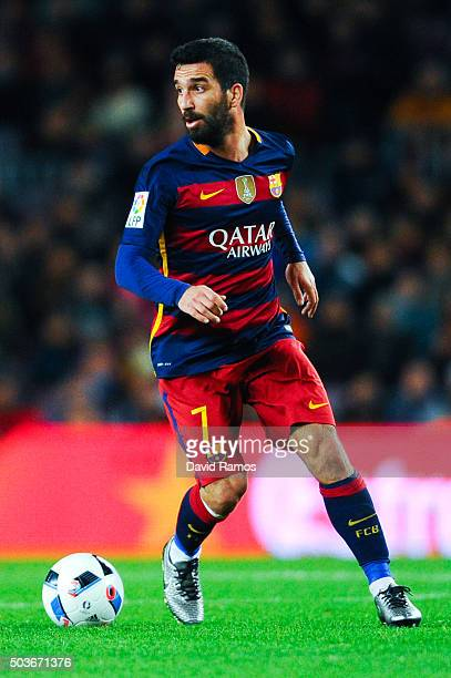 Arda Turan of FC Barcelona runs with the ball during the Copa del Rey Round of 16 first leg match between FC Barcelona and RCD Espanyol at Camp Nou...