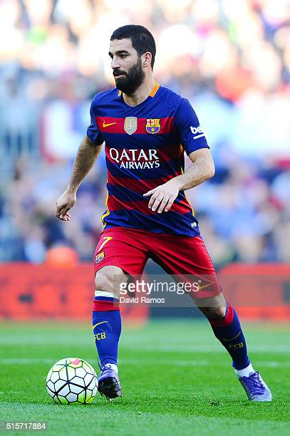 Arda Turan of FC Barcelona runs with the ball during the La Liga match between FC Barcelona and Getafe CF at Camp Nou on March 12 2016 in Barcelona...
