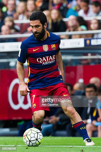 Arda Turan of FC Barcelona runs with the ball during the La Liga match between FC Barcelona and RCD Espanyol at Camp Nou on May 8 2016 in Barcelona...