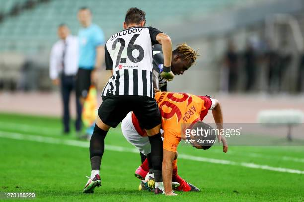 Arda Turan of Galatasaray in action against Omar Buludov of Neftchi during the UEFA Europa League second qualifying round match between Neftchi FK...