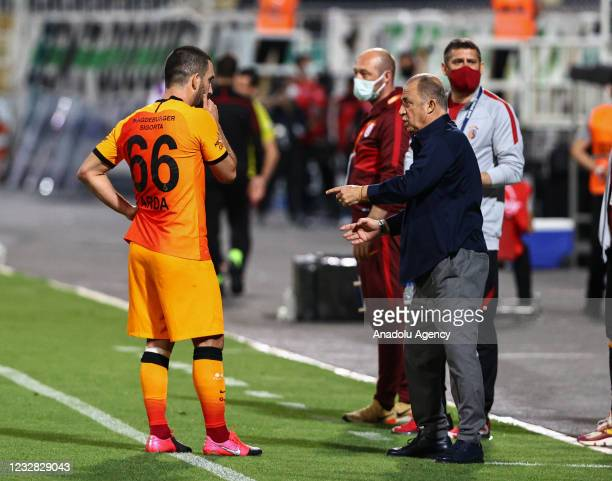 Arda Turan of Galatasaray receives tactics from head coach Fatih Terim during the Turkish Super Lig week 41 match between Yukatel Denizlispor and...