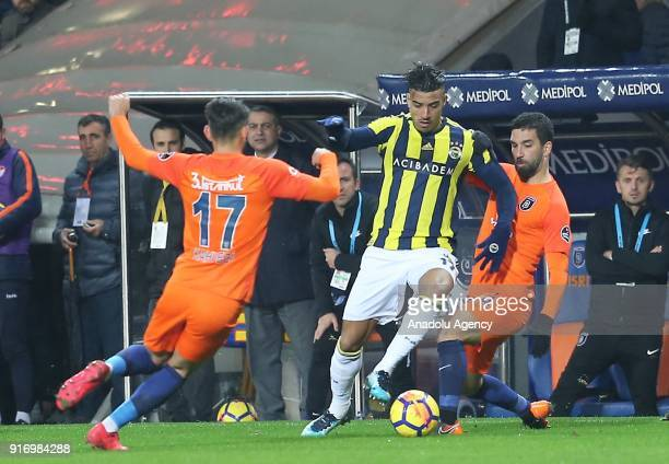 Arda Turan of Medipol Basaksehir in action against Nabil Dirar of Fenerbahce during the Turkish Super Lig soccer match between Medipol Basaksehir and...