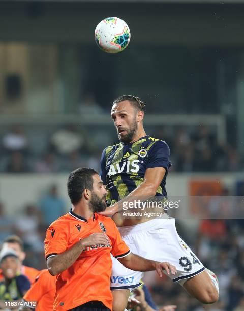 Arda Turan of Medipol Basaksehir in action against Vedat Muriqi of Fenerbahce during the Turkish Super Lig soccer match between Medipol Basaksehir...