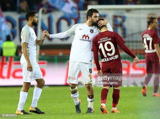 Arda Turan of Medipol Basaksehir kisses Abdulkadir Omur of Trabzonspor on his head during a Turkish Super Lig match between Trabzonspor and Medipol...