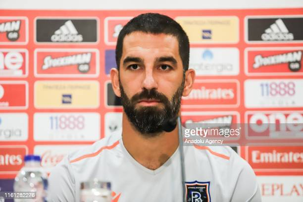 Arda Turan of Medipol Basaksehir speaks during a press conference ahead of the UEFA Champions League 3rd qualifying round match against Olympiacos at...