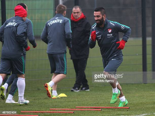 Arda Turan of Turkey exercises during the training session ahead of UEFA Euro 2016 qualifying match between Turkey and The Netherlands which will be...