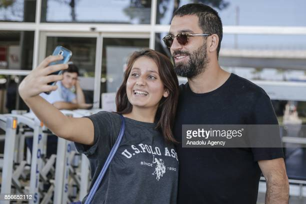 Arda Turan of Turkey poses for a photo with a woman after he arrives in Antalya with Turkish National Football Team ahead of the 2018 FIFA World Cup...