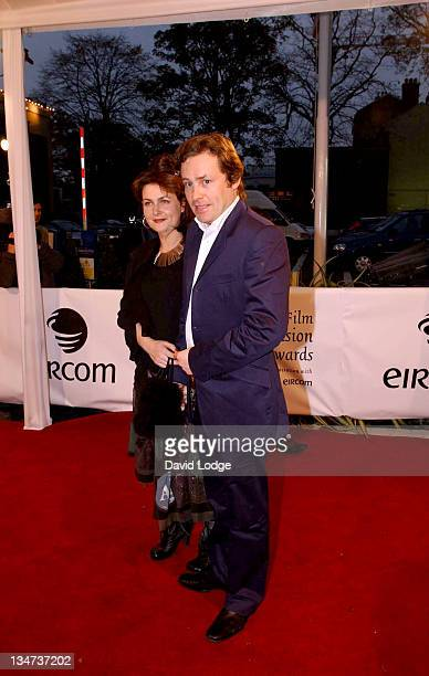 Ardal O'Hanlon and guest during The Irish Film and Television Awards 2004 Arrivals at The Burlington Hotel in Dublin Ireland