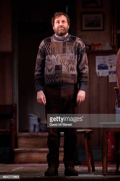 Ardal O'Hanlon bows at the curtain call during the press night performance of The Weir at Wyndhams Theatre on January 21 2014 in London England