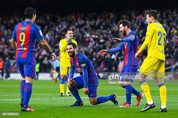 Ardan Turan of FC Barcelona celebrates with his team mates Luis Suarez and Lionel Messi after scoring his team's fourth goalduring the La Liga match...