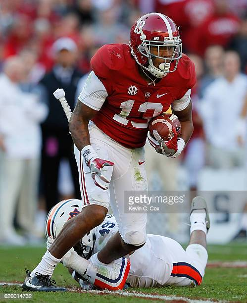 ArDarius Stewart of the Alabama Crimson Tide attempts to break a tackle by Darrell Williams of the Auburn Tigers at BryantDenny Stadium on November...