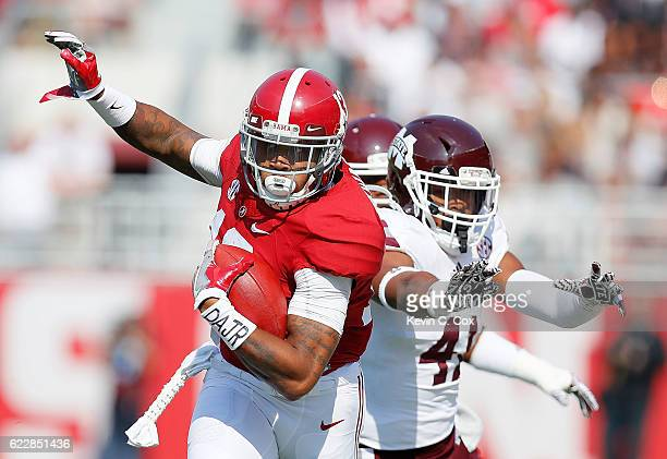 ArDarius Stewart of the Alabama Crimson Tide is pushed out of bounds by Mark McLaurin of the Mississippi State Bulldogs at BryantDenny Stadium on...