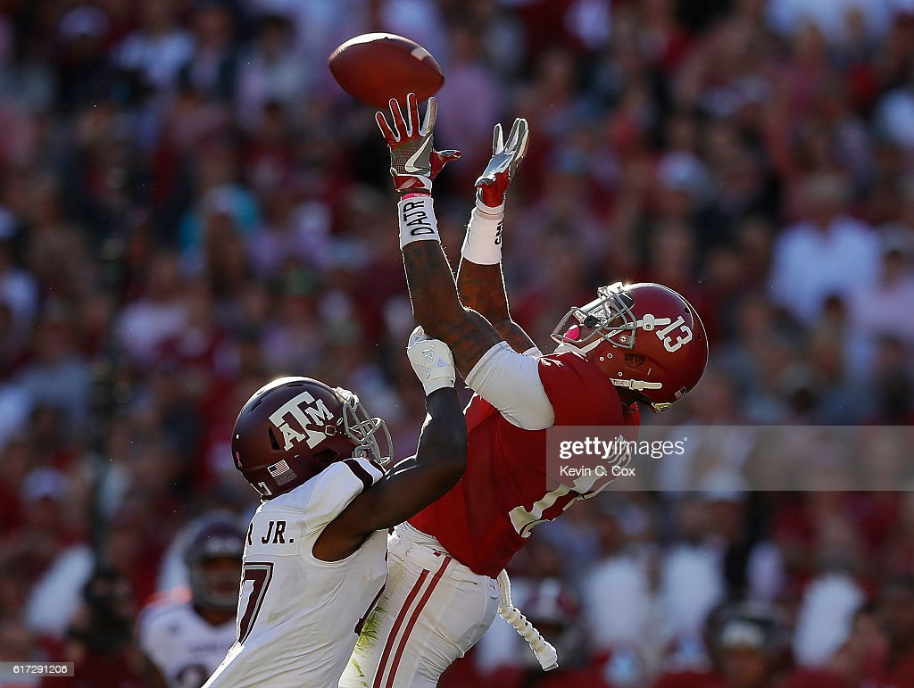 ArDarius Stewart #13 of the Alabama Crimson Tide pulls in this reception against Alex Sezer #17 of the Texas A&M Aggies at Bryant-Denny Stadium on October 22, 2016 in Tuscaloosa, Alabama.