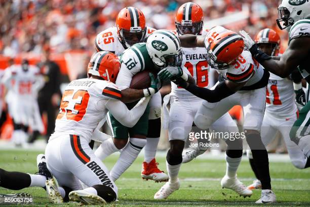 ArDarius Stewart of the New York Jets attempts to move the ball by Christian Kirksey of the Cleveland Browns and Joe Schobert of the Cleveland Browns...