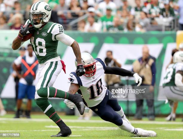 ArDarius Stewart of the New York Jets returns a kick against Matthew Slater of the New England Patriots in the second half during their game at...