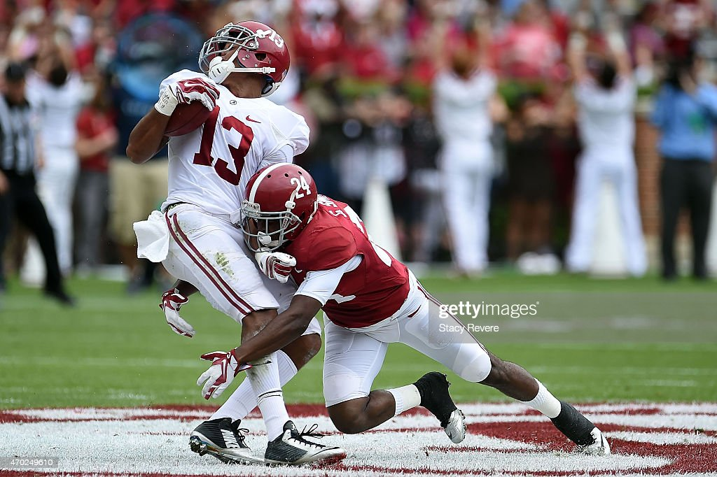 ArDarius Stewart #13 of the White team is brought down by Geno Smith #24 of the Crimson team during the University of Alabama A Day spring game at Bryant-Denny Stadium on April 18, 2015 in Tuscaloosa, Alabama.