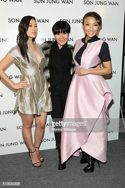 Arden Cho Son Jung Wan and Jeannie Mai pose backstage at the Son Jung Wan Fall 2016 fashion show during New York Fashion Week The Shows at The Dock...