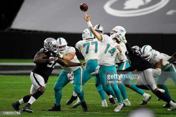 Arden Key of the Las Vegas Raiders is penalized for a face mask against Ryan Fitzpatrick of the Miami Dolphins during the fourth quarter of a game at...
