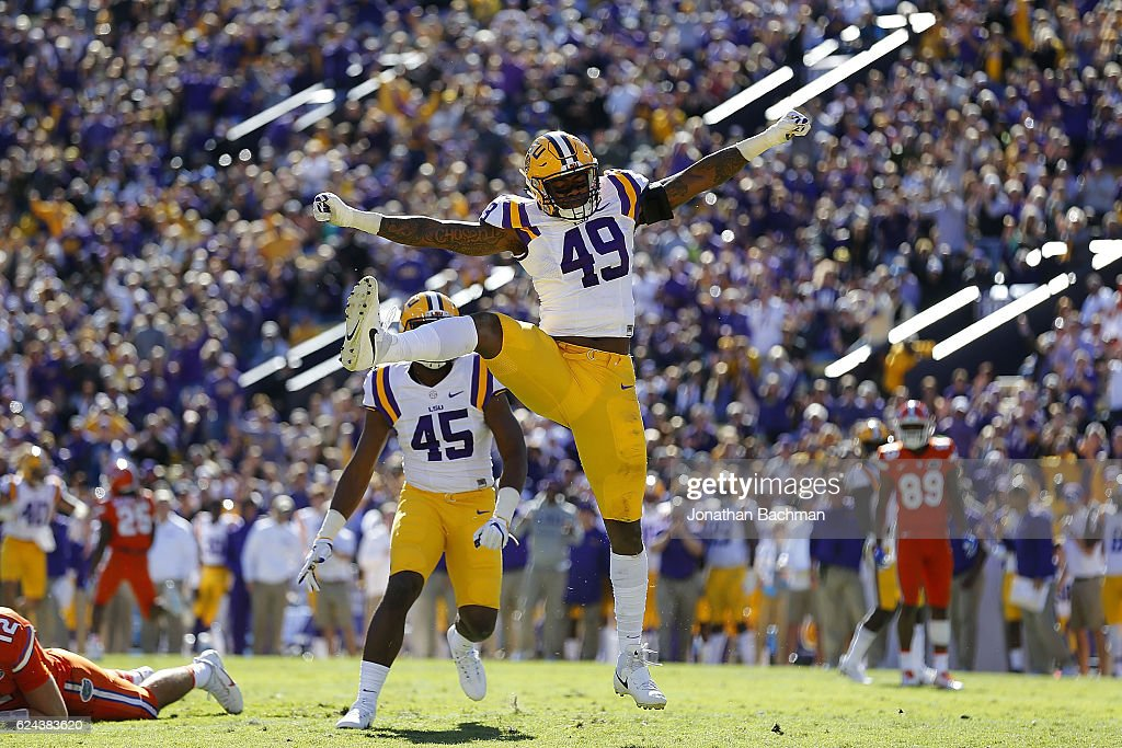 Arden Key #49 of the LSU Tigers celebrates a sack during the first half of a game against the Florida Gators at Tiger Stadium on November 19, 2016 in Baton Rouge, Louisiana.