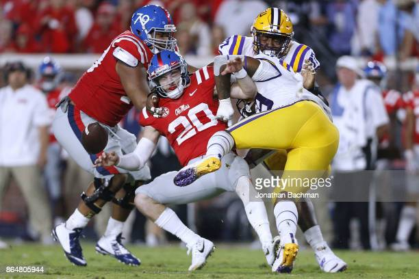 Arden Key of the LSU Tigers forces a fumble on Shea Patterson of the Mississippi Rebels during the first half of a game at VaughtHemingway Stadium on...