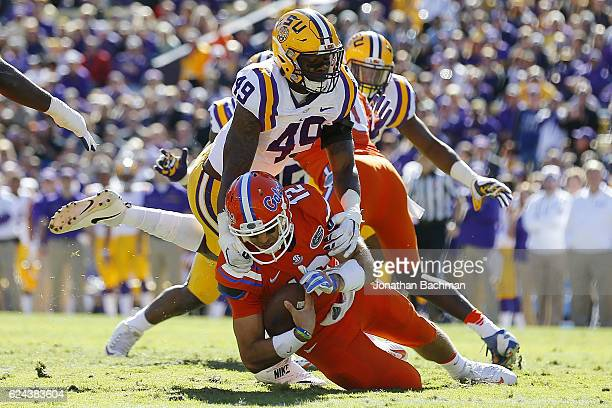 Arden Key of the LSU Tigers sacks Austin Appleby of the Florida Gators during the first half of a game at Tiger Stadium on November 19 2016 in Baton...