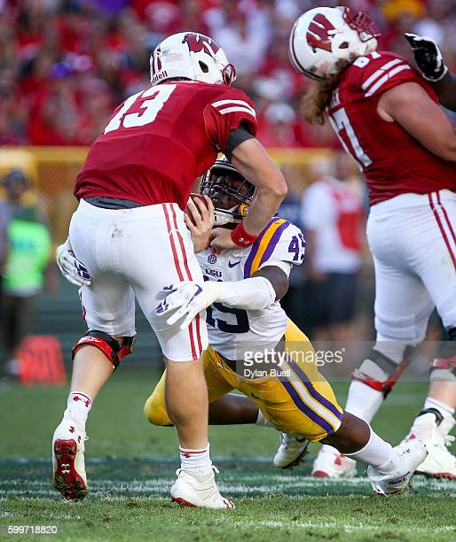 Arden Key of the LSU Tigers sacks Bart Houston of the Wisconsin Badgers in the fourth quarter at Lambeau Field on September 3 2016 in Green Bay...