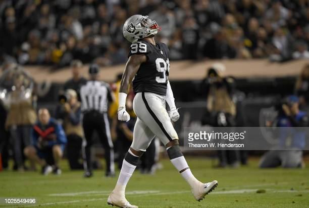 Arden Key of the Oakland Raiders celebrates after he sacked the quarterback against the Green Bay Packers during the second quarter of an NFL...