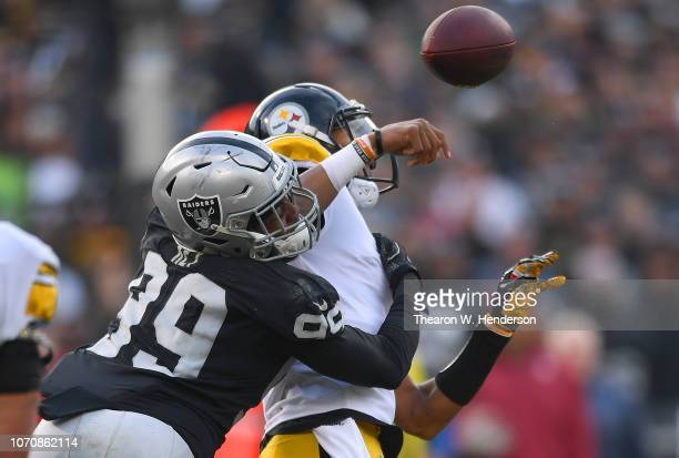 Arden Key of the Oakland Raiders puts the pass pressure on quarterback Joshua Dobbs of the Pittsburgh Steelers during the third quarter of their NFL...