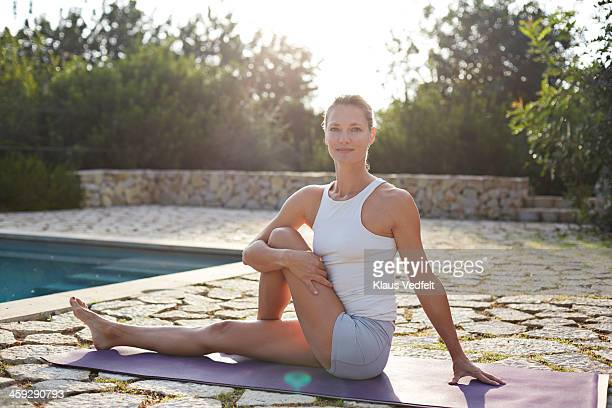 ardha matsyendrasana, half lord of the fishes pose - klaus vedfelt mallorca stock pictures, royalty-free photos & images