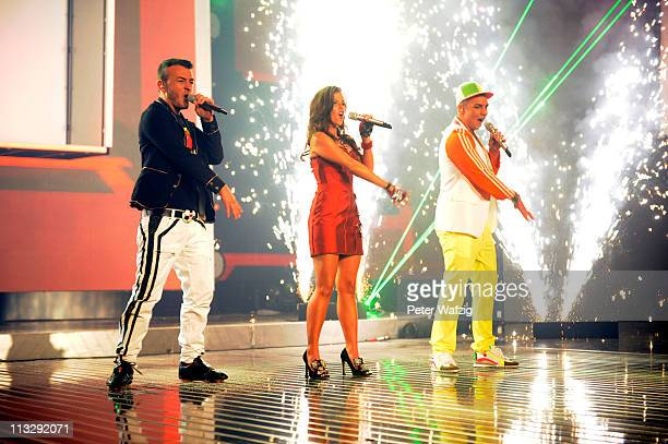 Ardian Bujupi Sarah Engels and Pietro Lombardi perform the opening song during the 'Deutschland Sucht Den Superstar' TV Show on April 30 2011 in...