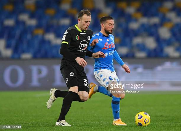 Ardian Ismajli of Spezia battles for possession with Dries Mertens of S.S.C. Napoli during the Coppa Italia match between SSC Napoli and Spezia...