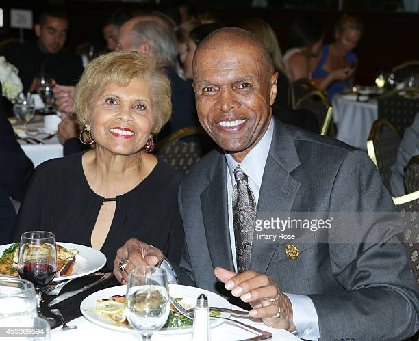 Ardie Bullard and football player Gale Sayers attend the 14th Annual Harold Carole Pump Foundation Event on August 8 2014 in Los Angeles California