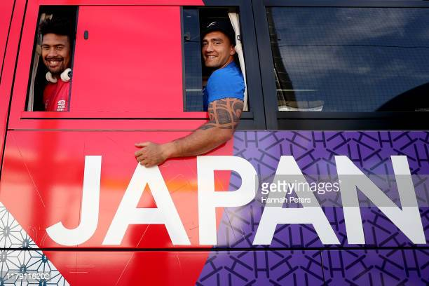 Ardie Savea and Codie Taylor of the All Blacks leave on the team bus following the New Zealand Captain's Run at the Arcs Urayasu Park on October 05...