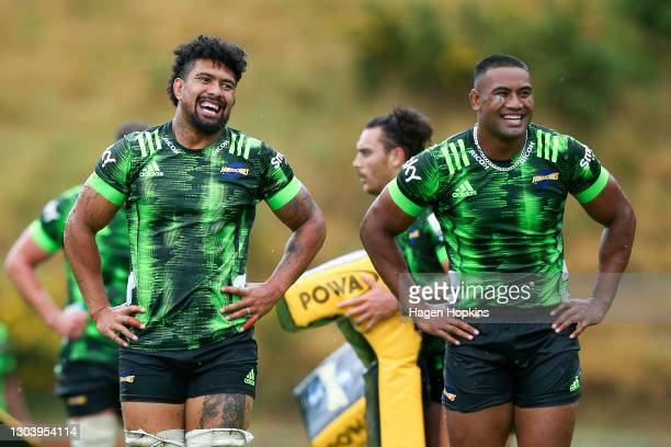 Ardie Savea and Julian Savea enjoy a laugh during a Hurricanes Super Rugby Aotearoa training session at Rugby League Park on February 25, 2021 in...