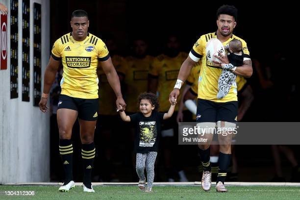 Ardie Savea and Julian Savea of the Hurricanes walk out onto the ground during the round one Super Rugby Aotearoa match between the Hurricanes and...
