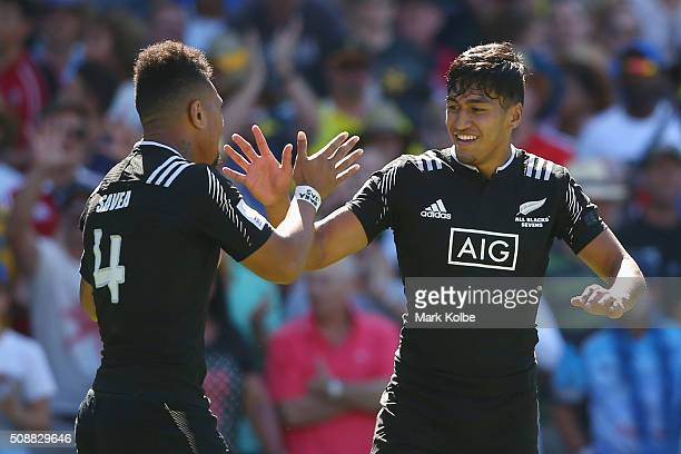 Ardie Savea and Rieko Ioane of New Zealand celebrate victory during the 2016 Sydney Sevens cup semi final match between New Zealand and Fiji at...