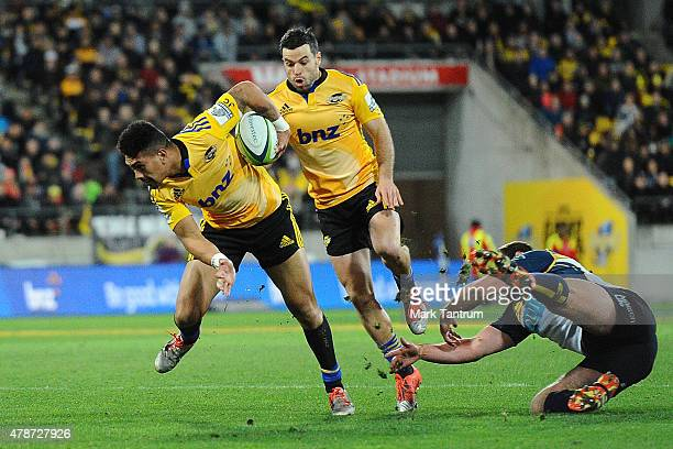 Ardie Savea breaks through a Brumbies tackle during the Super Rugby Semi Final match between the Hurricanes and the Brumbies at Westpac Stadium on...