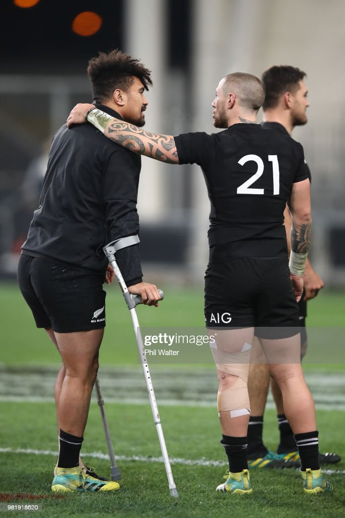 Ardie Savea (L) is consoled by TJ Perenara (R) following the International Test match between the New Zealand All Blacks and France at Forsyth Barr Stadium on June 23, 2018 in Dunedin, New Zealand.