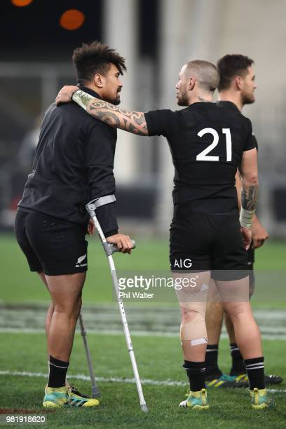 Ardie Savea is consoled by TJ Perenara following the International Test match between the New Zealand All Blacks and France at Forsyth Barr Stadium...