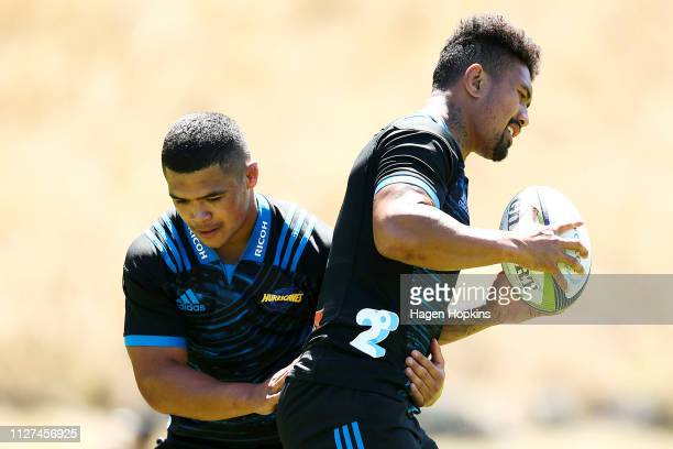Ardie Savea is tackled by Du'Plessis Kirifi during the Hurricanes Media Session at Rugby League Park on February 05 2019 in Wellington New Zealand