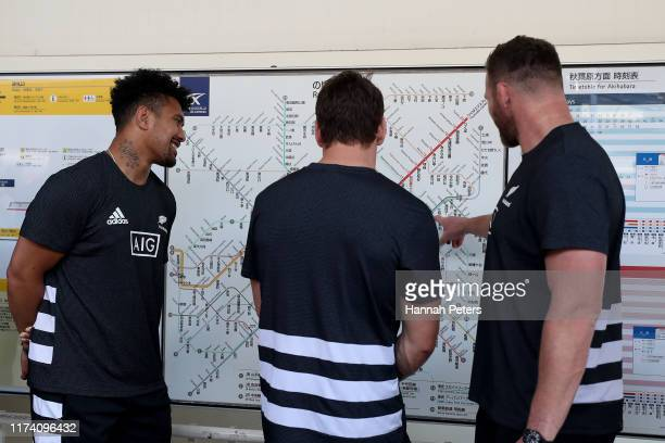 Ardie Savea, Matt Todd and Kieran Read of the All Blacks look at the Tokyo metro map while waiting for a train to launch a gesture of gratitude to...