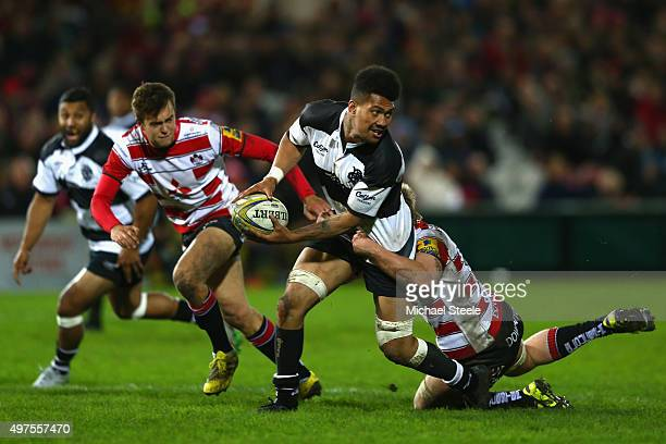 Ardie Savea of Barbarians looks for support as Dan Thomas of Gloucester holds on in the tackle during the Gloucester v Barbarians match at Kingsholm...