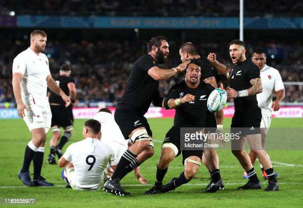 Ardie Savea of New Zealand celebrates scoring his teams first try with teammates Samuel Whitelock and TJ Perenara of New Zealand during the Rugby...
