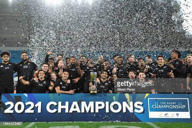 Ardie Savea of the All Blacks and team mates pose with the Rugby Championship trophy following The Rugby Championship match between the South Africa...