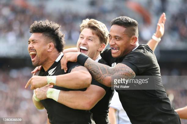 Ardie Savea of the All Blacks celebrates scoring a try with Beauden Barrett and Shannon Frizell of the All Blacks during the Bledisloe Cup match...