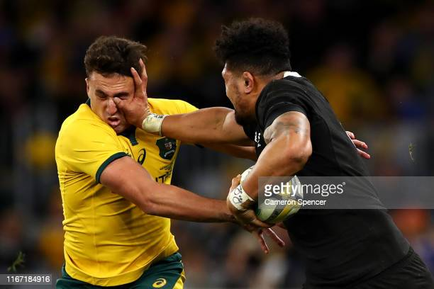 Ardie Savea of the All Blacks fends off Tom Banks of the Wallabies during the 2019 Rugby Championship Test Match between the Australian Wallabies and...