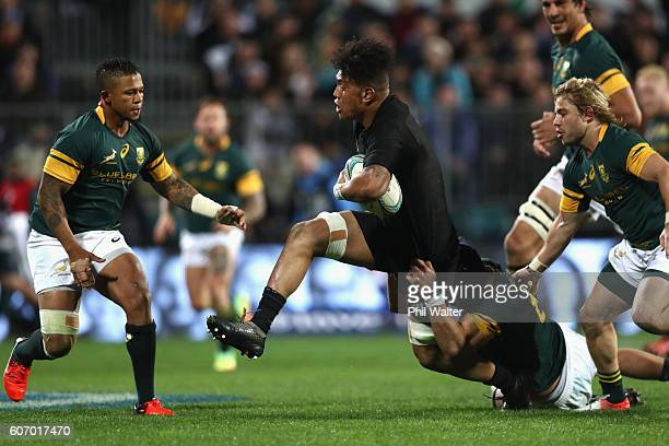 Ardie Savea of the All Blacks is tackled during the Rugby Championship match between the New Zealand All Blacks and the South Africa Springboks at...
