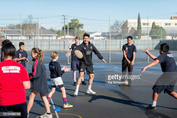 Ardie Savea of the All Blacks plays Rugby with students during a New Zealand All Blacks visit to Hillmorton High School on August 9 2018 in...