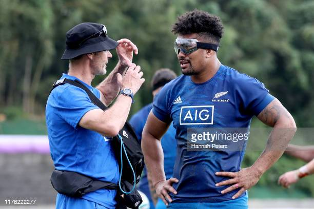 Ardie Savea of the All Blacks talks with team doctor Tony Page wearing rugby goggles during a New Zealand training session at Jissoji Tamokuteki...