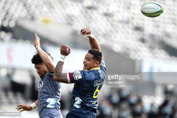 Ardie Savea of the Hurricanes competes with Shannon Frizell of the Highlanders in the lineout during the round 10 Super Rugby Aotearoa match between...